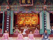 the participants of templestay are meditating in front of 'Daejeokgwangjeon'(means 'the hall of Great Peace and Light')